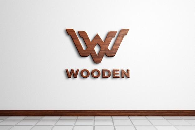 白い壁の3dレンダリングの木製ロゴモックアップ