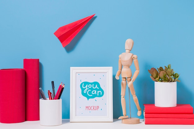 Wooden mannequin and school supplies with mock-up
