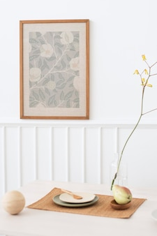 Wooden photo frame mockup hanging on a white wall