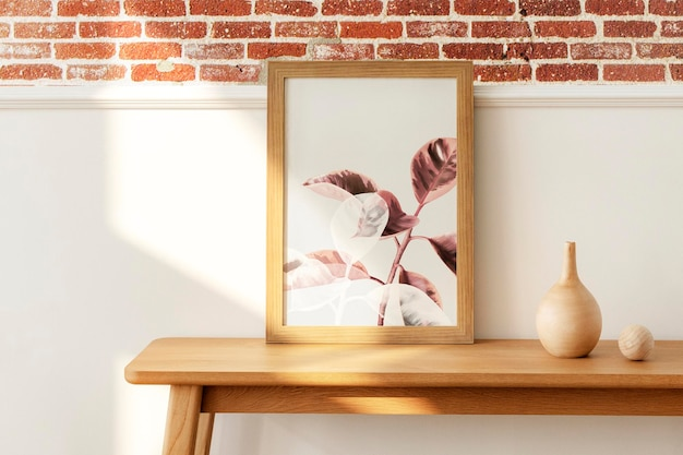 Wooden picture frame mockup on a wooden sideboard table