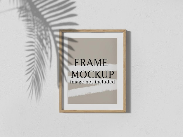Wooden poster frame mockup with tree shadow falling on it
