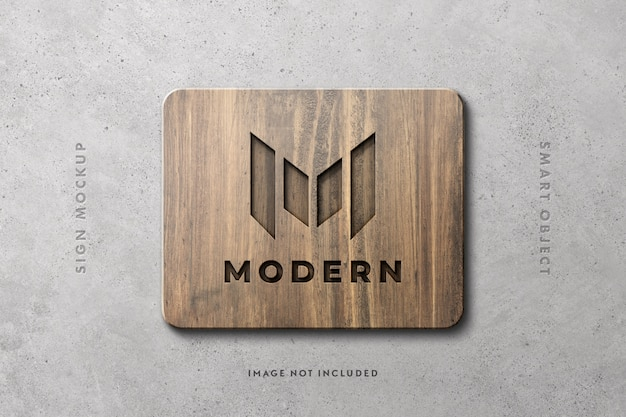 Wooden sign logo mockup on concrete wall