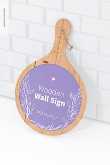 木製の壁のサインのモックアップ、傾いた