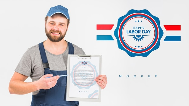 Worker holding clipboard mockup for labor day