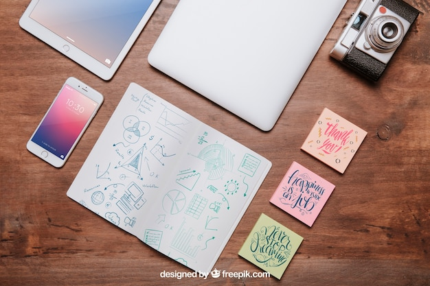 Workspace mockup from above with sticky notes