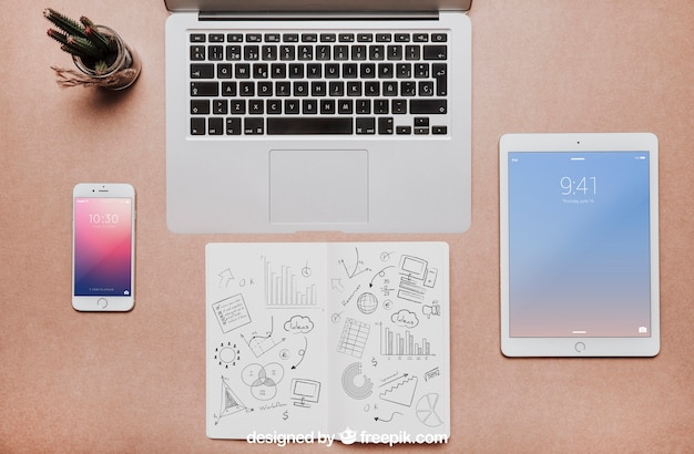 Workspace mockup with laptop and tablet