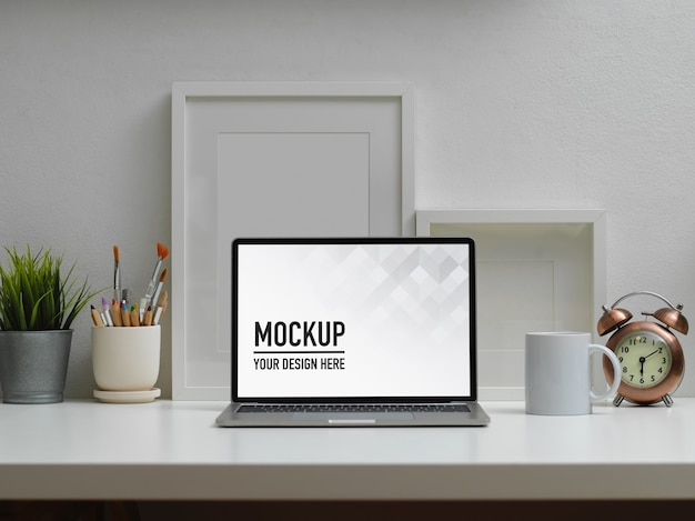 Workspace with digital tablet mockup, coffee cup and supplies