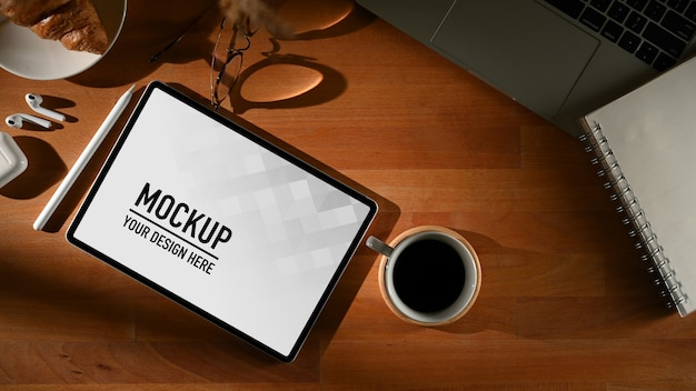 Workspace with digital tablet mockup with mug