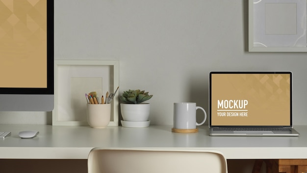 Workspace with laptop mockup, books and stationery