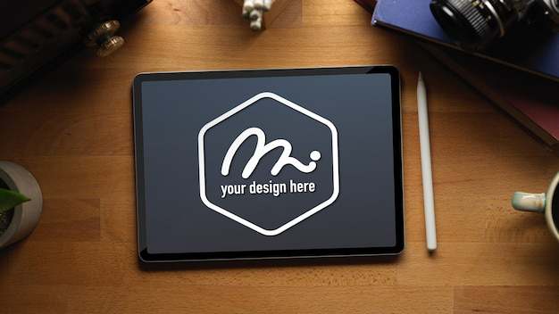 Workspace with mockup tablet, stylus pen and supplies