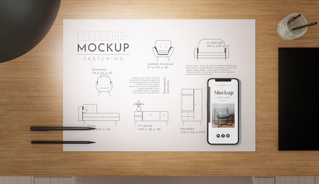 Рабочее пространство с эскизным макетом и мобильным телефоном