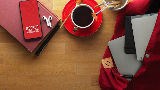 Workspace with smartphone mockup and coffee