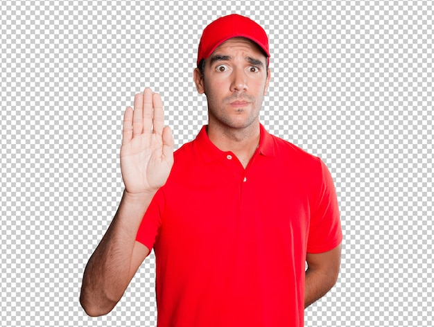 Worried delivery man with a gesture of stop