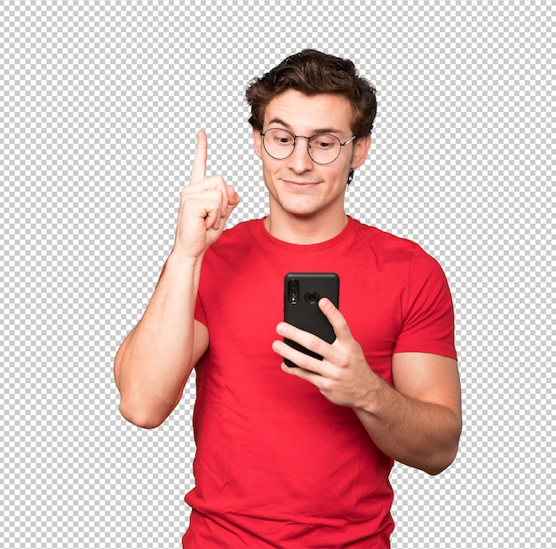 Worried young man pointing up and using his mobile phone