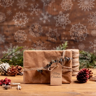 Wrapped paper gift with label and snowflakes