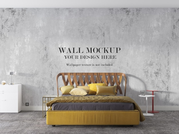 Yellow bed in front of mockup wall