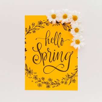 Yellow paper mockup with spring flowers