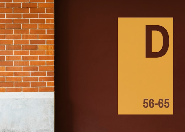 Yellow signboard mockup on a brown wall