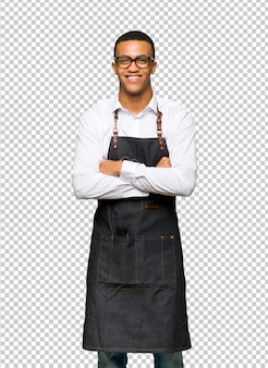 Young afro american barber man with glasses and happy