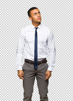 Young afro american businessman looking up with serious face