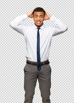 Young afro american businessman takes hands on head because has migraine