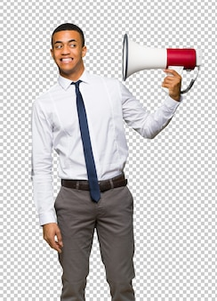 Young afro american businessman taking a megaphone that makes a lot of noise