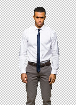 Young afro american businessman with sad and depressed expression
