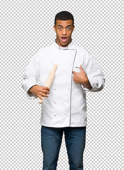 Young afro american chef man with surprise facial expression