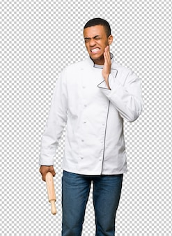 Young afro american chef man with toothache