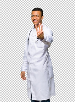 Young afro american man doctor happy and counting three with fingers