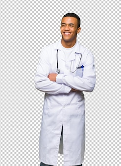 Young afro american man doctor happy and smiling