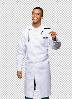 Young afro american man doctor holding a credit card