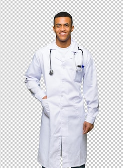 Young afro american man doctor posing with arms at hip and smiling
