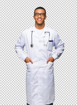 Young afro american man doctor with glasses and happy