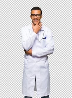 Young afro american man doctor with glasses and smiling