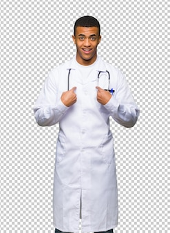 Young afro american man doctor with surprise facial expression