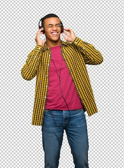 Young afro american man listening to music with headphones