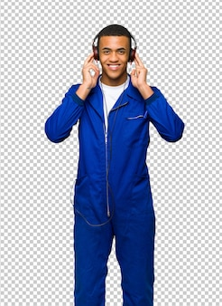 Young afro american worker man listening to music with headphones
