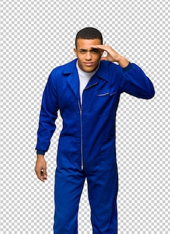 Young afro american worker man looking far away with hand to look something