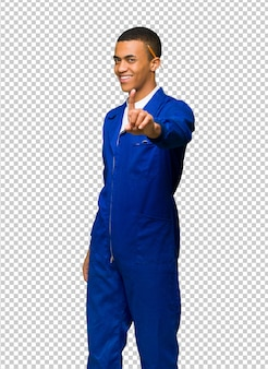 Young afro american worker man showing and lifting a finger