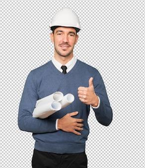 그의 손으로 괜찮아 제스처를 만드는 젊은 건축가