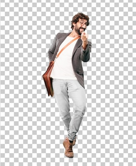 Young bearded businessman wearing blazer dancing expression