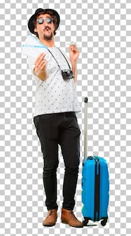 Young bearded cool traveller man with a bag. holidays concept