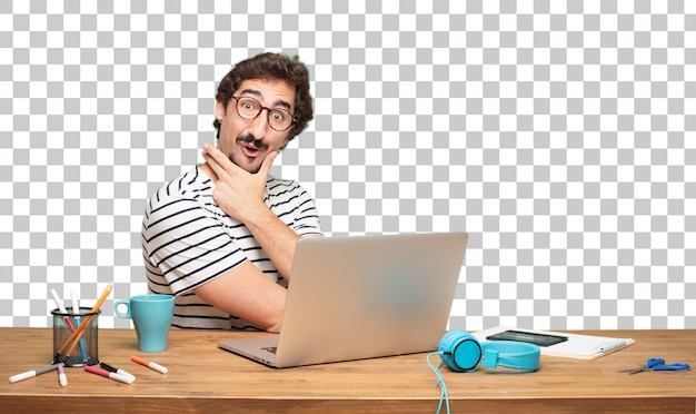 Young bearded man graphic designer. amazed or shocked expression