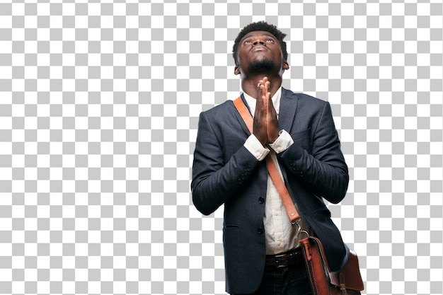 Young black businessman praying in a saintly manner, begging