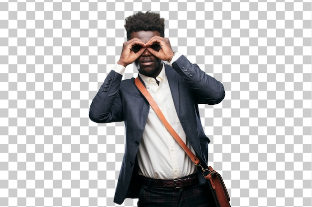 Young black businessman rubbing eyes in surprise and disbelief