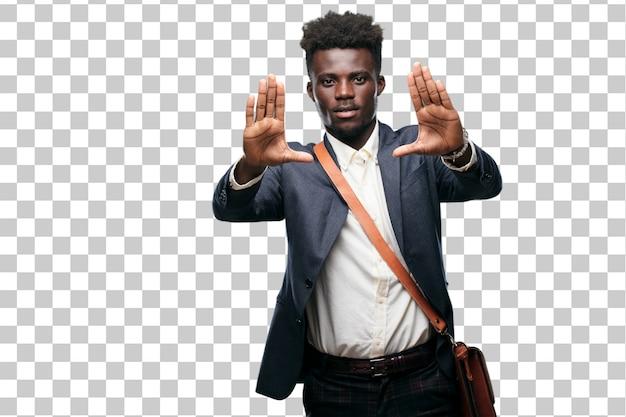 Young black businessman signaling stop
