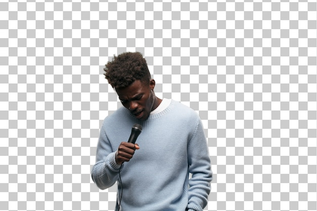Young black man singing with a microphone