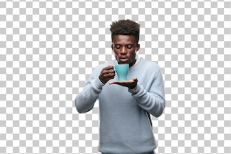 Young black man with a coffee cup