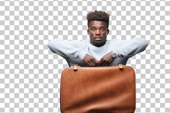 革ケースを持つ若い黒人。旅行や観光のコンセプト